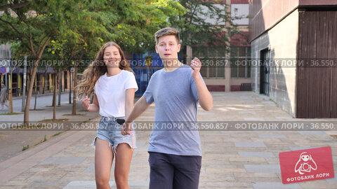Young man is walking and young girl is following him. Стоковое видео, видеограф Яков Филимонов / Фотобанк Лори