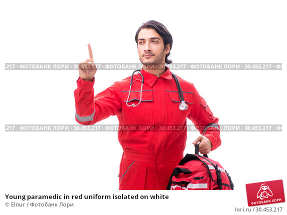 Young paramedic in red uniform isolated on white. Стоковое фото, фотограф Elnur / Фотобанк Лори