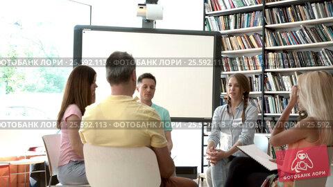 Купить «Young people in psychological therapy», видеоролик № 25592113, снято 29 июля 2016 г. (c) Raev Denis / Фотобанк Лори