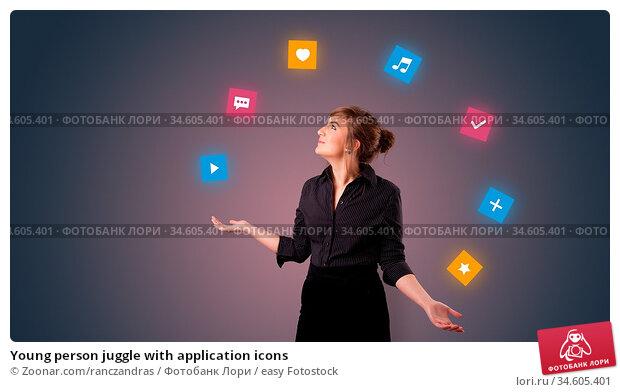 Young person juggle with application icons. Стоковое фото, фотограф Zoonar.com/ranczandras / easy Fotostock / Фотобанк Лори