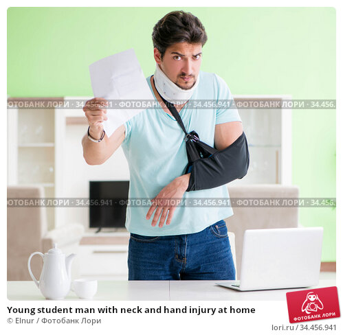 Young student man with neck and hand injury at home. Стоковое фото, фотограф Elnur / Фотобанк Лори