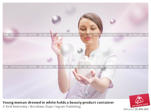 Купить «Young woman dressed in white holds a beauty product container», фото № 28486665, снято 7 января 2012 г. (c) Ingram Publishing / Фотобанк Лори