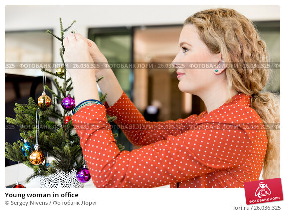 Купить «Young woman in office», фото № 26036325, снято 14 декабря 2014 г. (c) Sergey Nivens / Фотобанк Лори