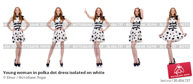 Young woman in polka dot dress isolated on white. Стоковое фото, фотограф Elnur / Фотобанк Лори