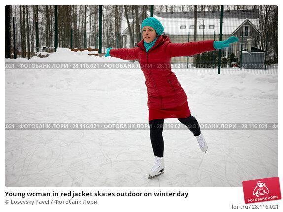 Купить «Young woman in red jacket skates outdoor on winter day», фото № 28116021, снято 4 февраля 2017 г. (c) Losevsky Pavel / Фотобанк Лори