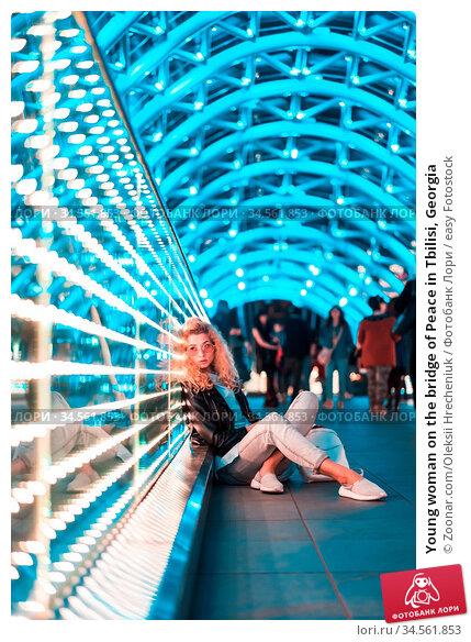 Young woman on the bridge of Peace in Tbilisi, Georgia. Стоковое фото, фотограф Zoonar.com/Oleksii Hrecheniuk / easy Fotostock / Фотобанк Лори