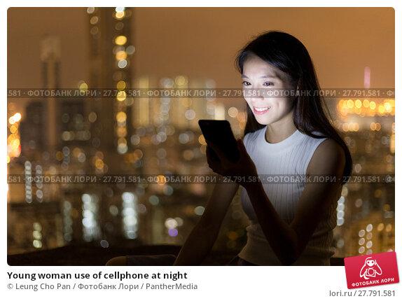 Купить «Young woman use of cellphone at night», фото № 27791581, снято 18 февраля 2018 г. (c) PantherMedia / Фотобанк Лори