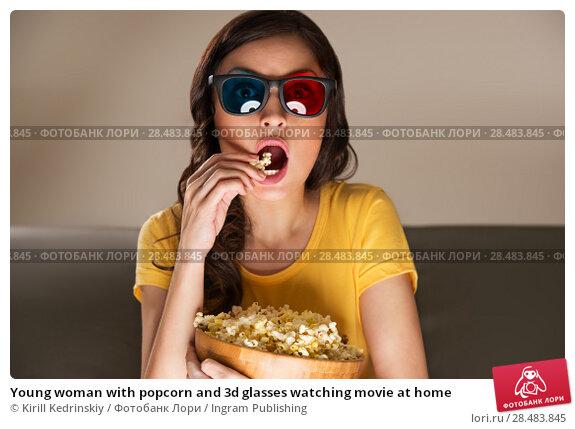 Купить «Young woman with popcorn and 3d glasses watching movie at home», фото № 28483845, снято 19 декабря 2012 г. (c) Ingram Publishing / Фотобанк Лори