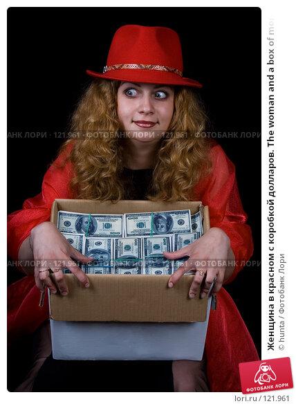 Купить «Женщина в красном с коробкой долларов. The woman and a box of money», фото № 121961, снято 17 июля 2007 г. (c) hunta / Фотобанк Лори